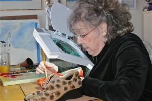 barbara painting corrective shoe under magnifier