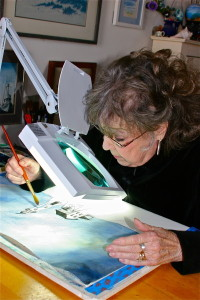 barbara painting canvas using table clamp magnifier