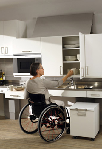 Awesome Lowered Kitchen Cabinet Accessed By Woman In Wheelchair
