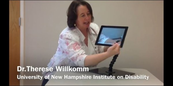 Dr. Willkomm demonstrates one of her solutions, an iPad holder