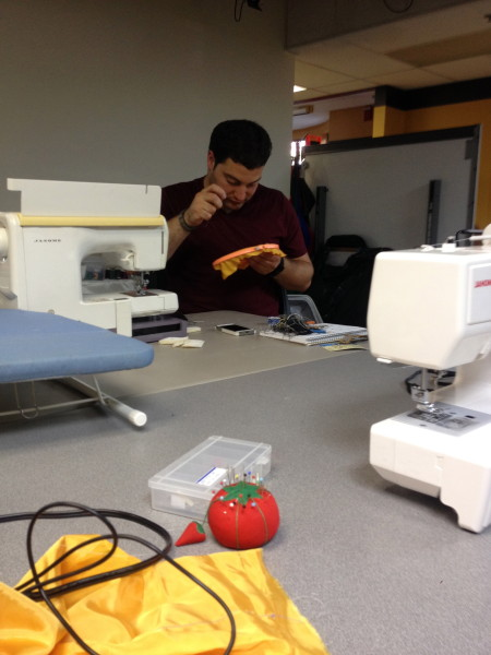 Student creating his clothing product for Open Style Lab