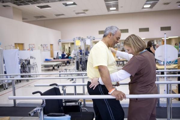 Brain injury therapist working with patient