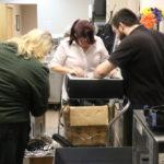 volunteers working in the depot