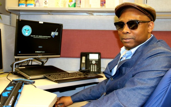 Jwyanza Maye sitting in his office space