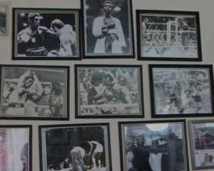 pictures of Ray's fights on his office wall
