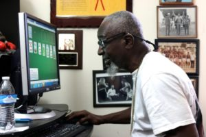 Ray using a computer that he received from ESC