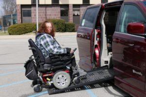 Roxanne entering her van on wheelchair ramp