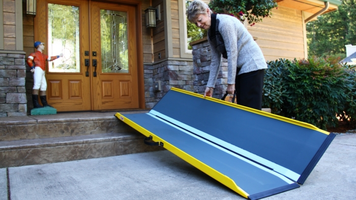 Woman folding up suitcase ramp
