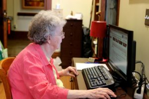 Sister Gloria using desktop computer