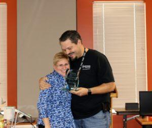 Wade Wingler hugging Peri Rogowski