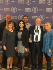 Members of advisory committee with champions of inclusion award