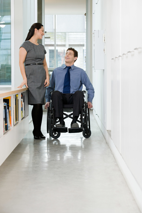 Female talking to male in wheelchair