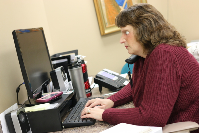 Tracy working at her desk