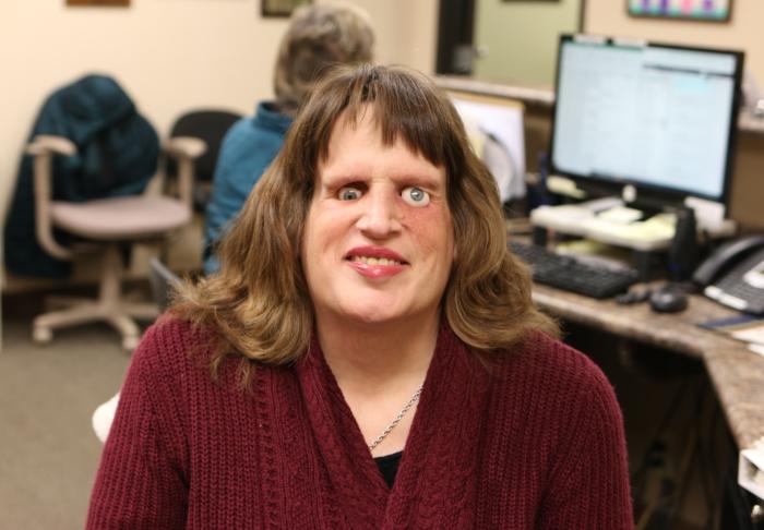 headshot of Tracy