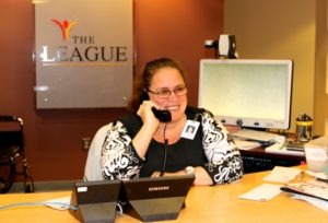 Anne Palmer answering phones at The League