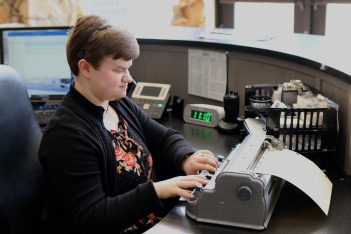 Jodi using her Braille embosser