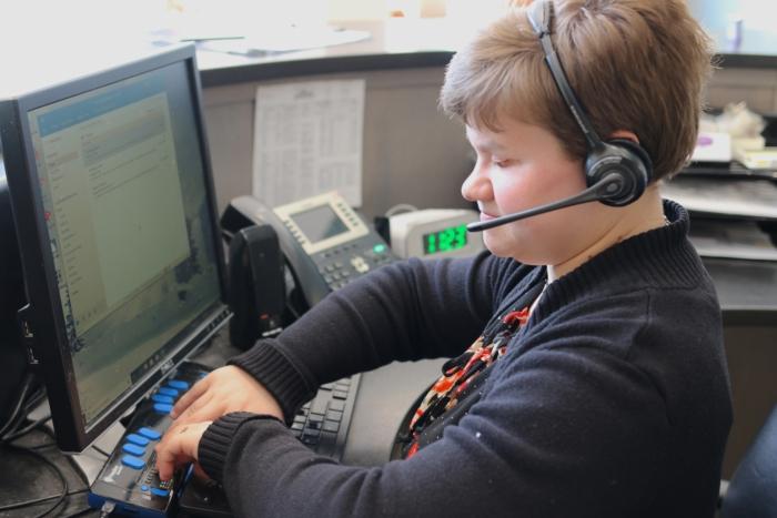 Jodi using braille notetaker
