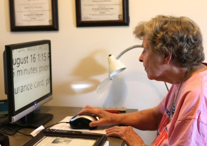 Mildred using desktop CCTV