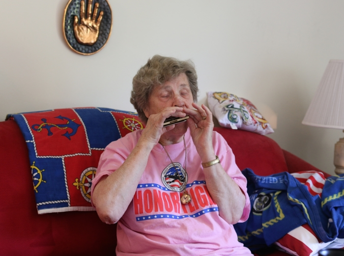 Mildred playing the harmonica