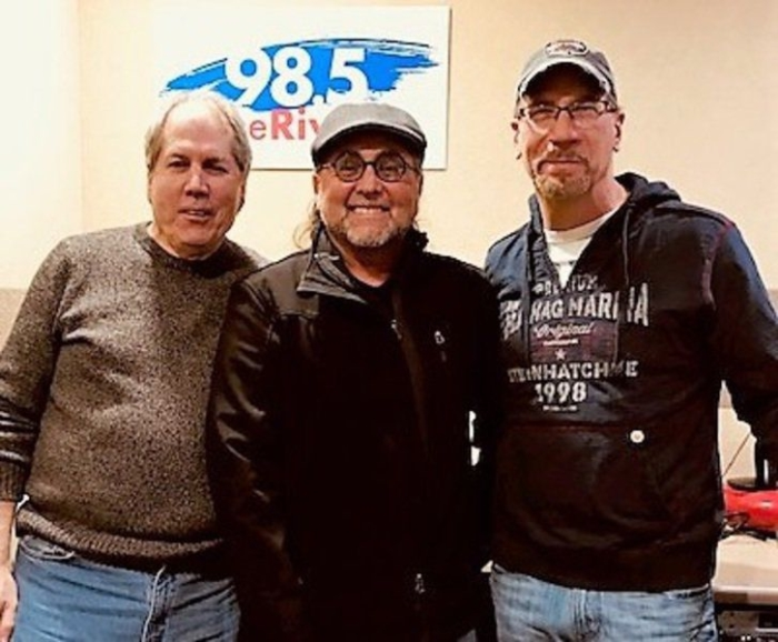 Danny Beemer with others at radio station