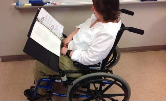 Book holder for wheelchair