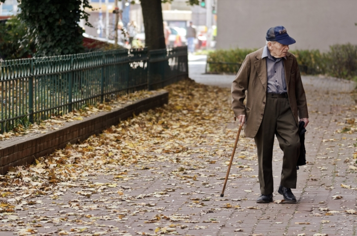 Veteran walking with cane