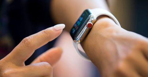 Woman using Apple Watch