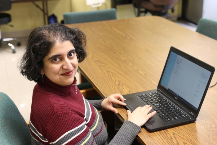 Radha working on laptop