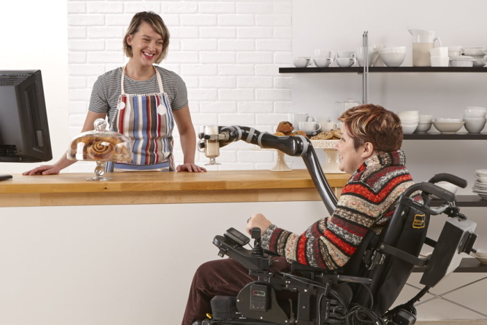Person in wheelchair with JACO arm