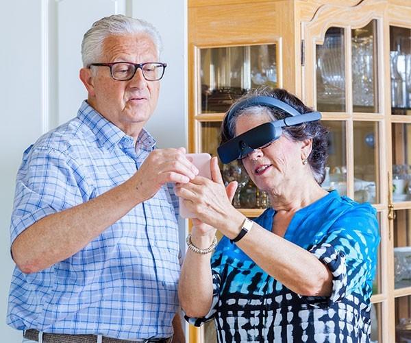 Couple using eSight4 glasses