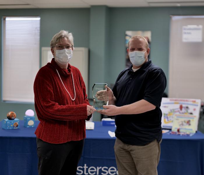 Deanna Austin being presented AT Champion award by Brian Norton