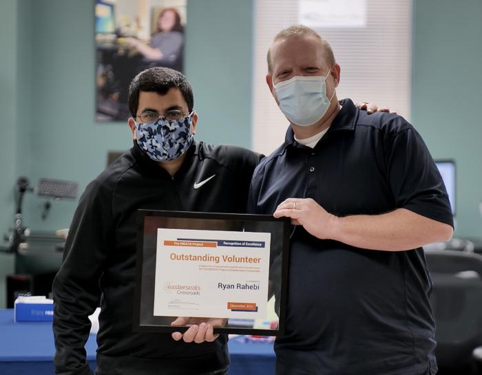 photo of Brian Norton awarding Ryan Rahebi 2020 Outstanding Volunteer award