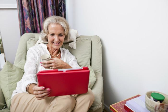 Senior using assistive technology