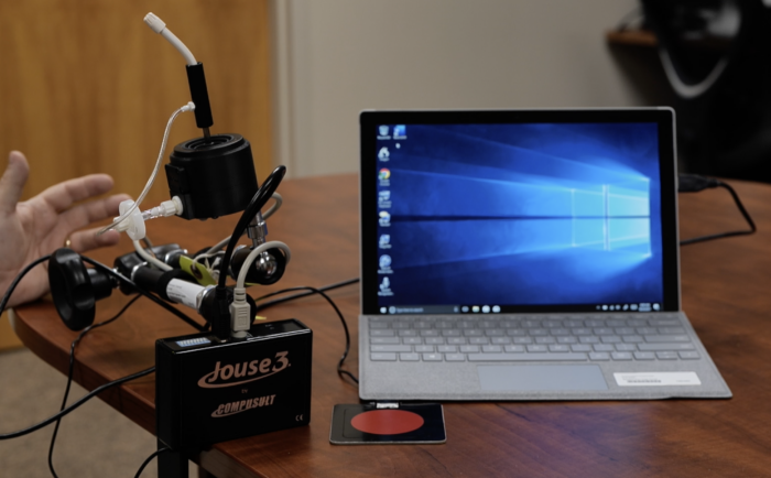 a photo of Jouse3 attached to a mac laptop