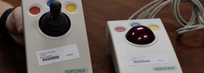 a photo of optima joystick and optima trackball